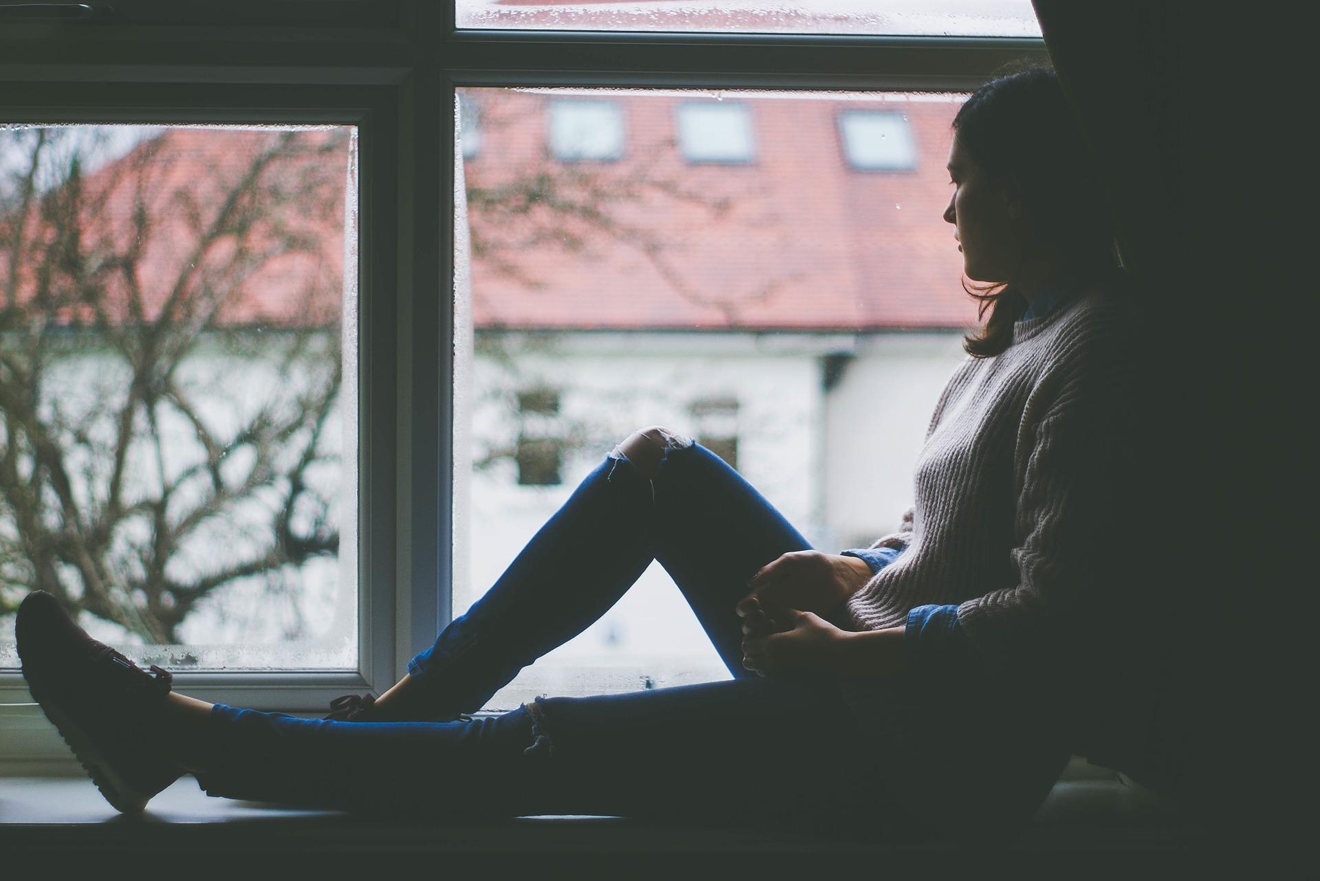 Woman sitting in the window